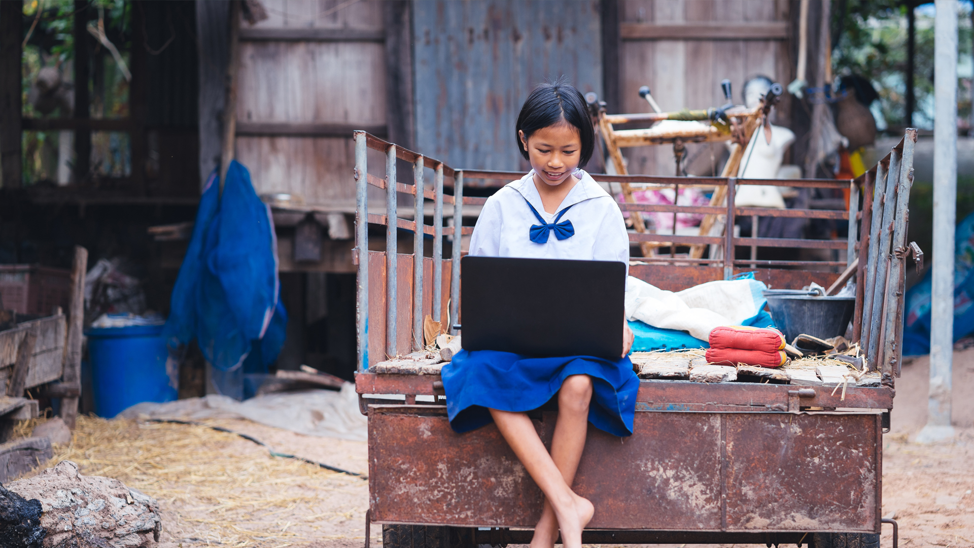 Vietnamese girl with uniform and laptop sitting